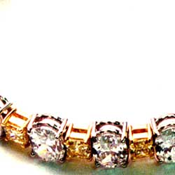 Oval White Diamonds and Yellow Radiants in Two-tone platinum and 18K Yellow Bracelet