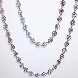 Platinum and Bezel-Set Diamond necklace. 60 inch Length