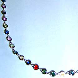 Platinum bezel set necklace with multi-colored round sapphires