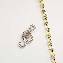 G-Clef Pendant in platinum and 2 tone bracelet